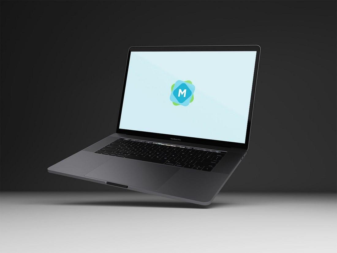 Free Floating Space Grey MacBook Pro Mockup