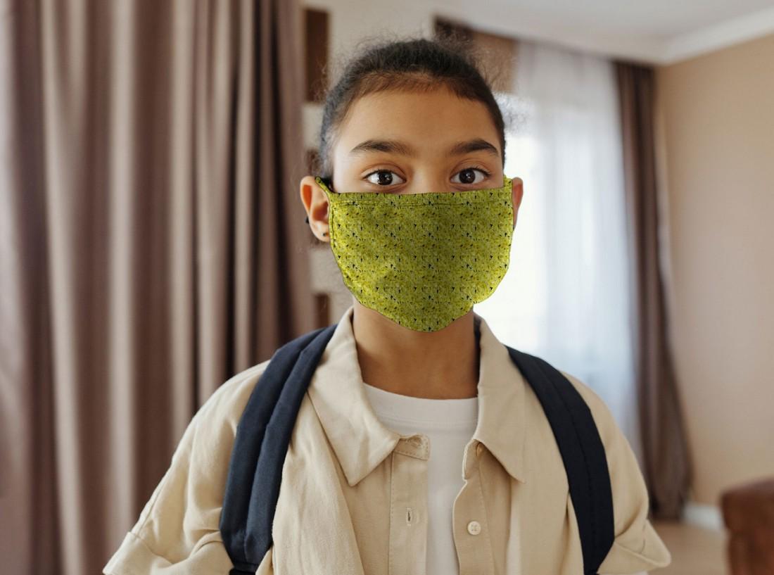 Free Girl Wearing a Face Mask Mockup