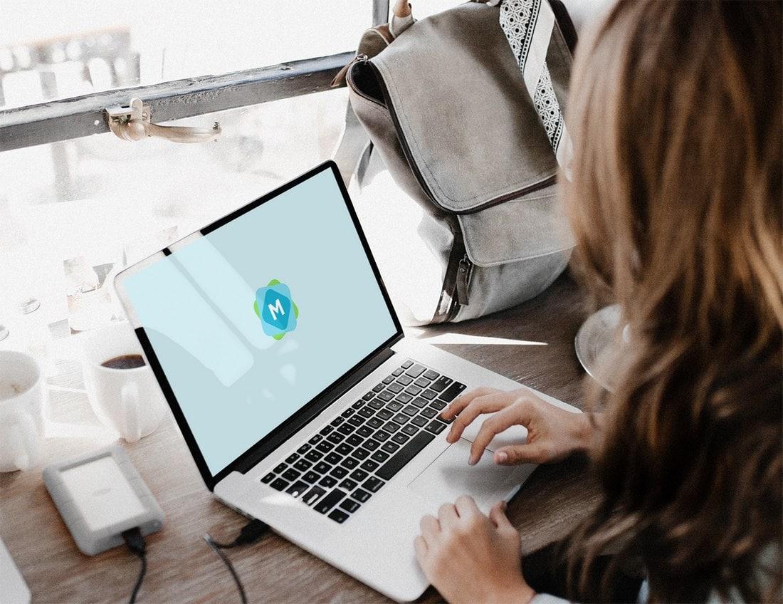 Free Woman Using a MacBook Mockup