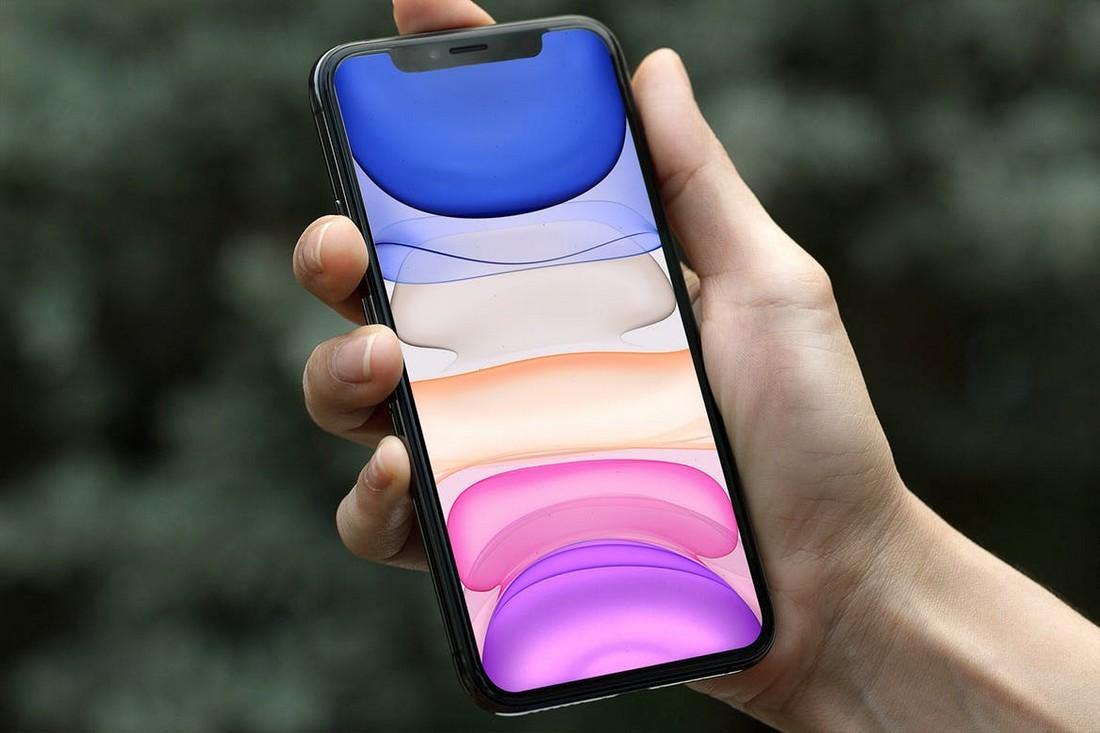 Hand Holding iPhone 11 Pro Mockup
