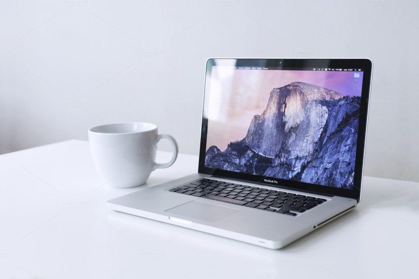 This one is a simple Apple MacBook Pro mockup with a plain coffee mug.