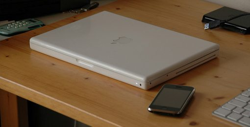 White MacBook with iPhone 3GS